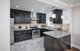 image of light granite countertops with dark cabinets