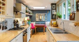 looking down the galley style kitchen which occupies the return space