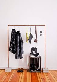 Copper and Concrete Clothes Rack: This garment rack is like the lace dress  and leather jacket combination, tough yet feminine. The copper pipe keeps  things ...