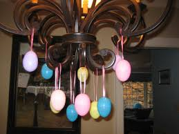 one of my favorite and easy ways to dress up for easter is with plastic eggs and the chandelier simply use those dozens of plastic eggs your child has