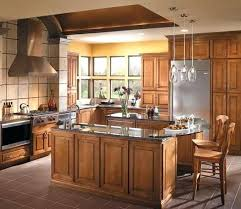 light brown kitchen cabinets cabinetry door style in maple finished in caramel with chocolate glaze light