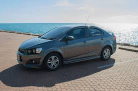 car insurance california parked car with beach scenery in the background