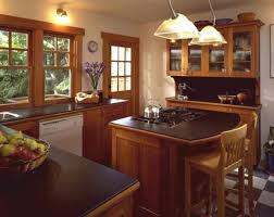 kitchen island design ideas. Full Size Of Interior Brown Wooden Cabinet With Black Counter Top Plus Kitchen Island Stove Above Design Ideas