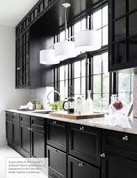 black kitchen cabinets with white marble countertops. Interesting Kitchen Natural Light As Balancing Feature And Black Kitchen Cabinets With White Marble Countertops K
