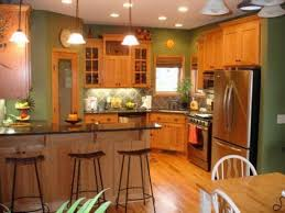 honey oak kitchen cabinets with black countertops and green kitchen ideas with honey oak cabinets