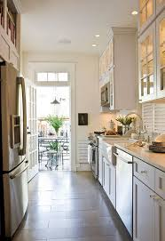 Kitchen tile flooring Modern Galley Kitchen Which Direction To Run The Tile Floor Designer Paul Corrie Sincere Home Decor Which Direction Should You Run Your Tile Flooring Well Designed