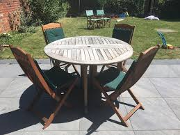 circular 4 seater wooden garden table 4 chairs with cushions and 2 extra director chairs