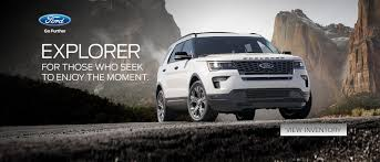 a ford explorer parked in front of dramatic mountains