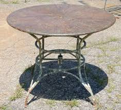 round outdoor metal table. An Unique Indoor Or Outdoor Round Metal Garden Umbrella Table With Surface Of Colors Splayed From E