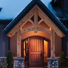 timber frame covered entryway with snow craftsman front porches craftsman home exterior craftsman style