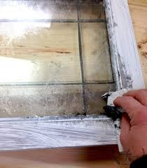 dab on a paint mixture of paint to make a faux mercury glass mirror