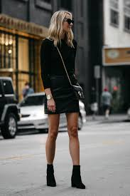 blonde woman wearing club monaco black sweater top black leather mini skirt outfit gucci marmont handbag