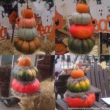 fall porch decorated with pumpkin topiaries
