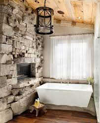 traditional bathroom fireplaces montana stone wall bathroom with inset gas fireplace peacedesign via atticmag