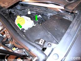 porsche cayenne fuel injector replacement 2003 2008 pelican pull the two fuse panel cover pins up green arrows up and out of