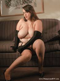 Fatty babe with massive jugs Isabelle Lane stripping and teasing.