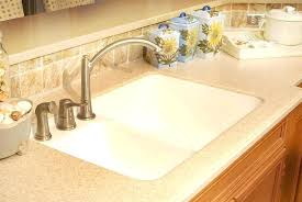 solid surface countertops vs quartz solid surface vs quartz domestic kitchen with quartz and chestnut cabinets