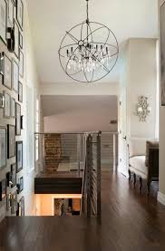 chandelier foyer hall transitional with sloped ceiling brown chandeliers