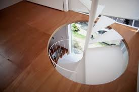spiral stairs of super small house in modern design