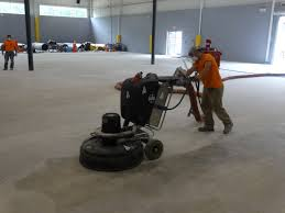 Concrete Floor Grinder Used In The Polishing Process For This Gym Floor