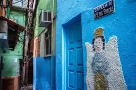 colorful slums  favelas  of rio de janeiro  brazil – photo essay    cables everywhere  but the chapel is in order   vila canoas slum  favela