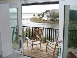 shutters for glass sliding doors open up completely so that your view is never obstructed