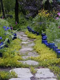 garden pathway. Create A Small Fence Around The Pathway Using Recycled Bottles Or Jars Garden