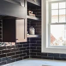blue kitchen backsplash dark cabinets. Glossy Black Tiles With Dark Blue Cabinets Kitchen Backsplash