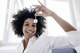 Woman holding mirror ball Stock Photo 166298928