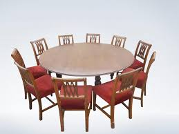 large round victorian oak dining table to seat up to 10 people