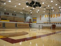 to the existing gymnasium space in which the existing wood floor was replaced with new graphics added bleachers and light fixtures were replaced