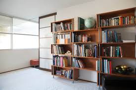 office bookshelf design. Enchanting Office Bookshelf Design With Brown Wooden Storage Cabinet For Bookcase Above White Fur Rugs Also Wall Plus Glass Windows W E