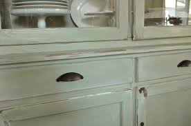 how to make old kitchen cabinets look new how to make a new peice of furinture look old with paint and distressi