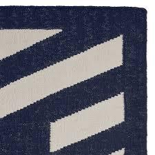striped border indoor outdoor rug navy