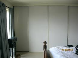 wood panel sliding closet doors for bedrooms furniture interior princely three door ideasmodern modern mirrored