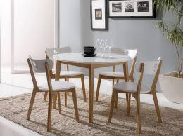 modern white round dining table set for 4
