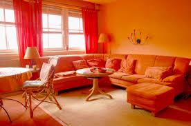 red and orange bedroom | Orange living room - Red, yellow & orange themes