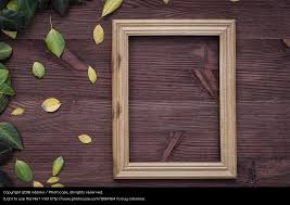 empty wooden frame on brown wood surface a royalty free stock photo from photocase