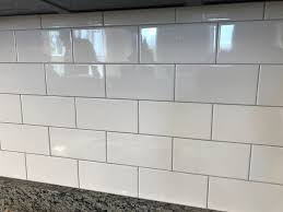 the client used the same back splash grout combination we used at our langley model white subway tile with timberwolf grout i love the light gray grout