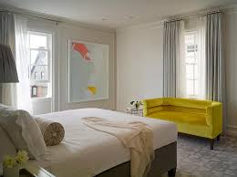gray bedroom with yellow sofa