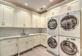 Traditional Laundry Room with Santa Fe Panel, Built-in bookshelf, High  ceiling,