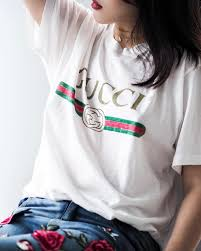 gucci tee. t-shirt: logo tee, tumblr, gucci, logo, white t-shirt, jeans, denim, embroidered, embroidered necklace, gold jewels, jewelry, gucci tee m