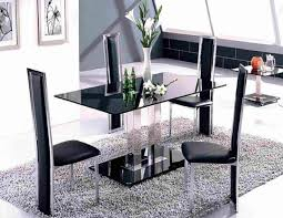 enjoyable black glass rectangle two base modern dining table and four modern dining chairs set on grey fur rug as open dining room decorating designs