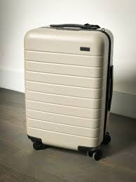 photos and features of the away suitcase with phone charger