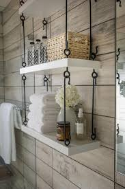 Custom designed hanging shelves add much-needed storage to the bathroom.