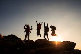 Premium Photo | Climbing group friends jumping on top mountain and amazing  sunset sky .