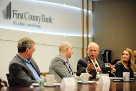 chairman and ceo of first county bank rey giallongo second from right talks during