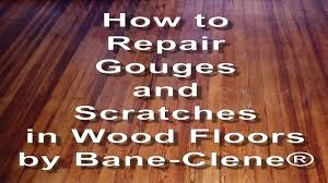 how to repair scratches gouges and holes in wood floors