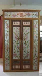 pooja room designs in glass pooja