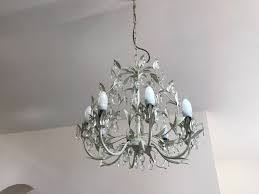 8 light cream coloured chandelier with glass pendants from laura ashley